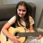 our student with her guitar