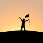 person at the top of a hill